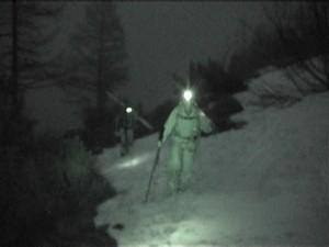 Skiers in the Dark